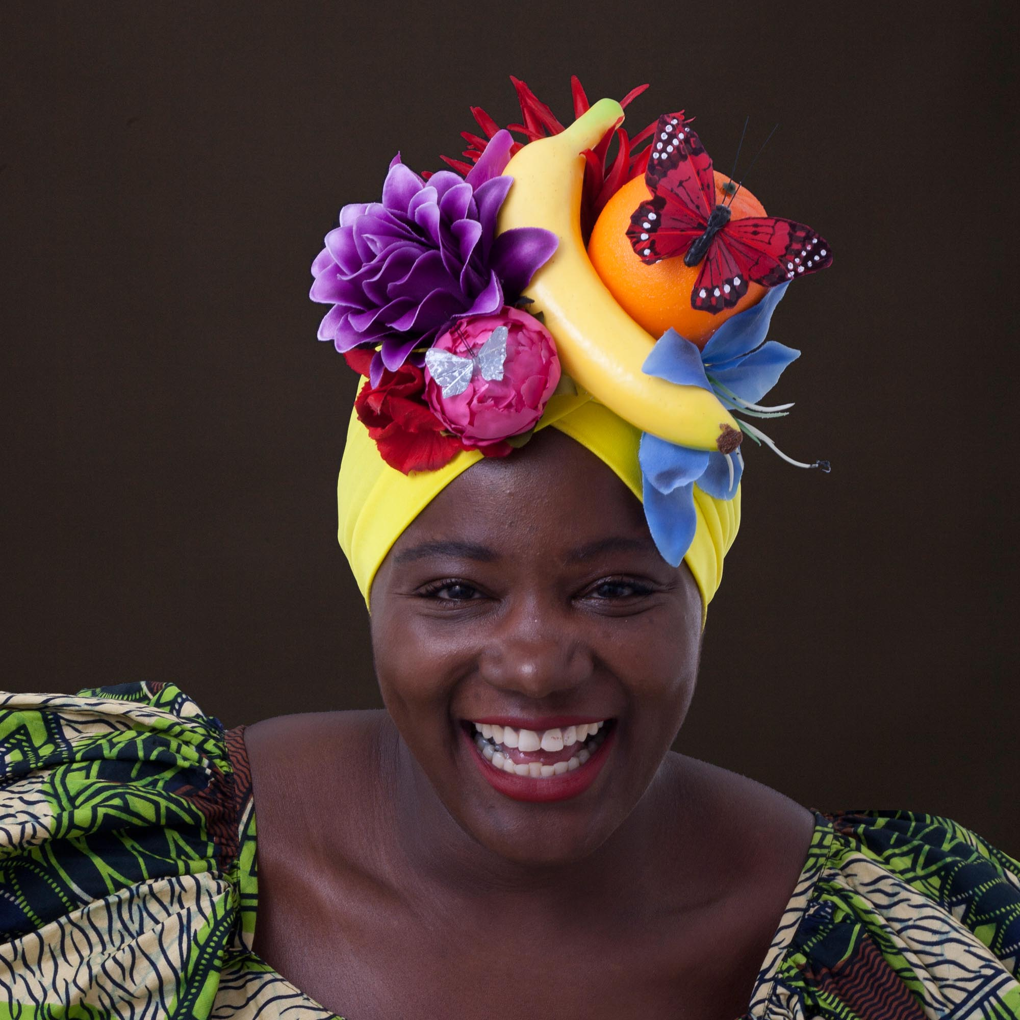 Smiling woman wearing a fruity turban